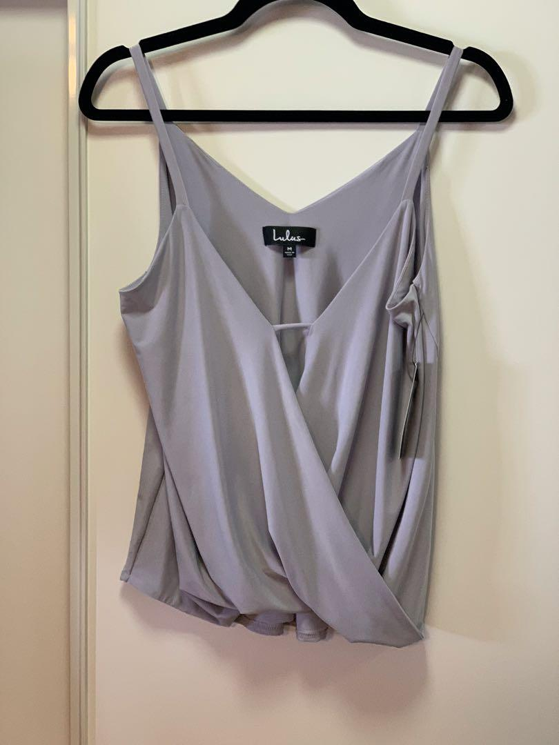 LULUS BEAUTIFUL STYLISH TOP. Great for New Years. Please look at other adds.