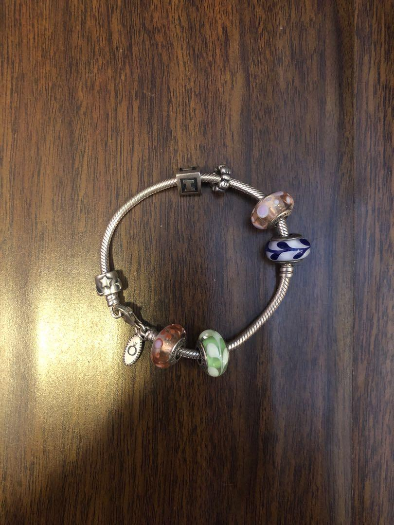 Pandora bracelet with 7 charms: completely authentic