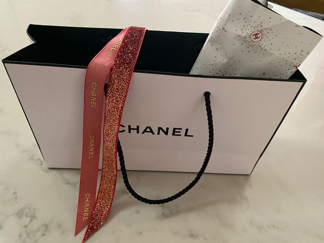 Chanel gift bag authentic with wrapping and ribbon *new condition*