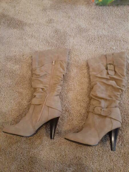 Women's brown boots. Three quarter knee high. Size 7. Never worn. Price Negotiable.