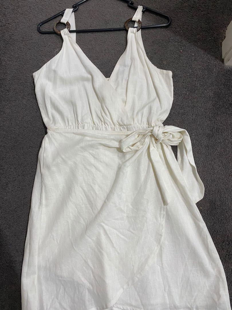 White linen dress with wrap skirt and plunge neckline. Brand new never worn.