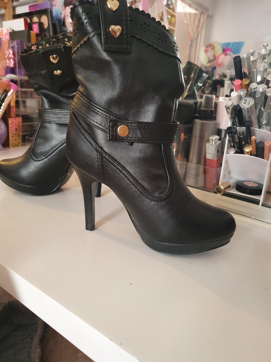 Size AU 6 / EUR 37 / UK 4 / US 6 Women's Black Bow boot with removable strap