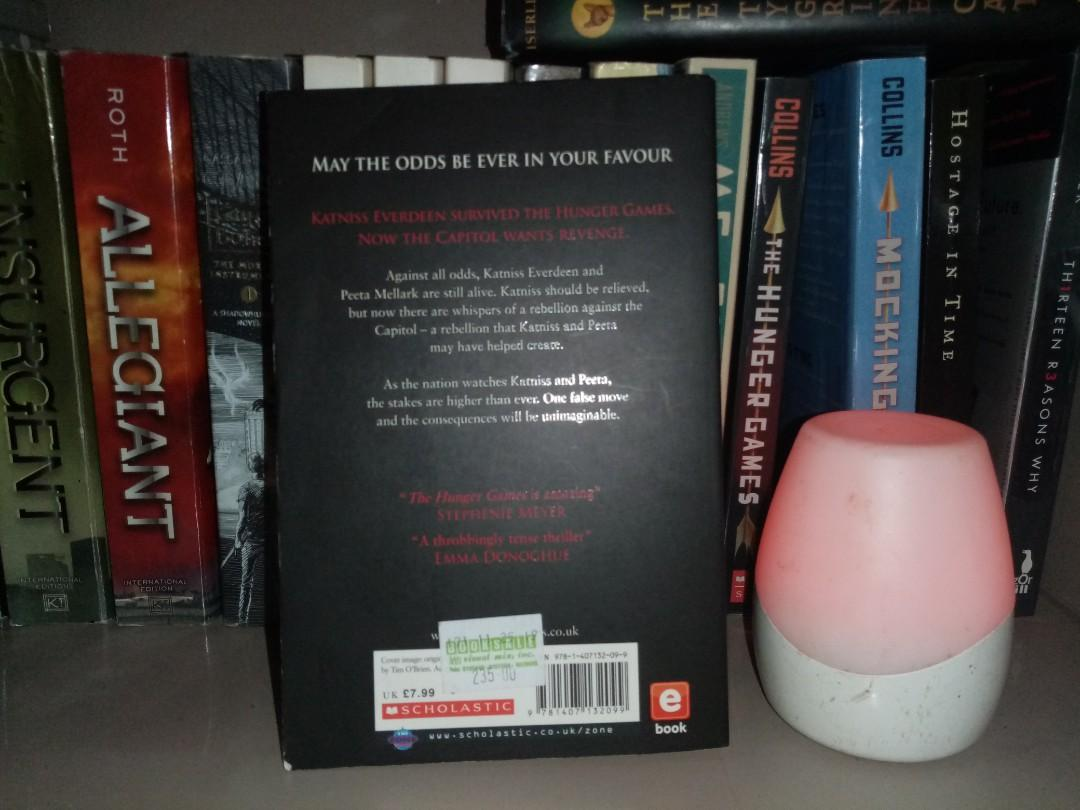 HUNGER GAMES: THE CATCHING FIRE by Suzanne Collins (Buy or swap for Catching Fire with the red cover)