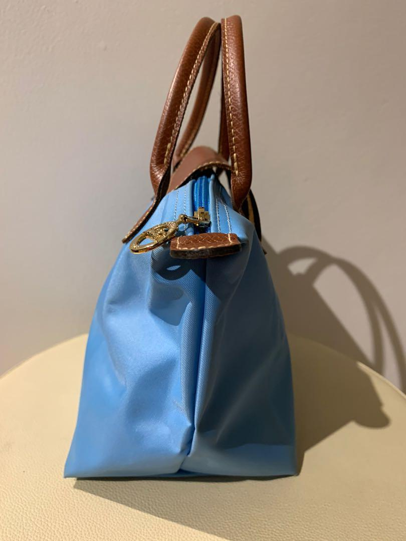 Authentic Longchamp leather small size hang bag in baby blue