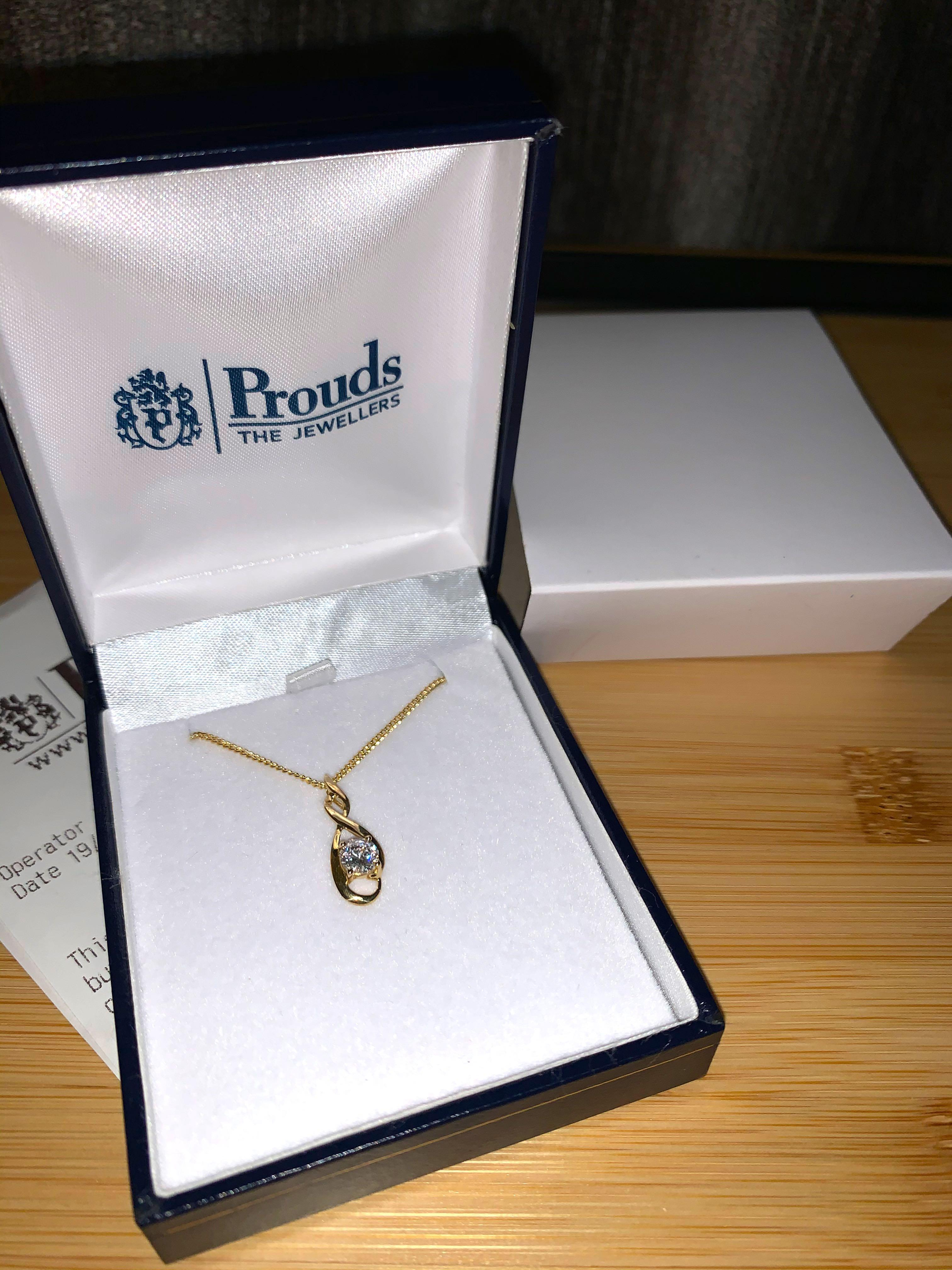 Prouds 9ct gold cubic zirconia 5mm round brilliant cut open twist pendant with the chain