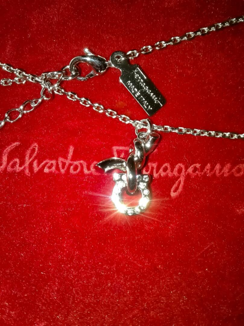Brilliant Salvotore Ferragamo Silver Plated Brass Necklace With Nodo / Knot Style Pendant Embedded With Diamond Like Glass Crystal