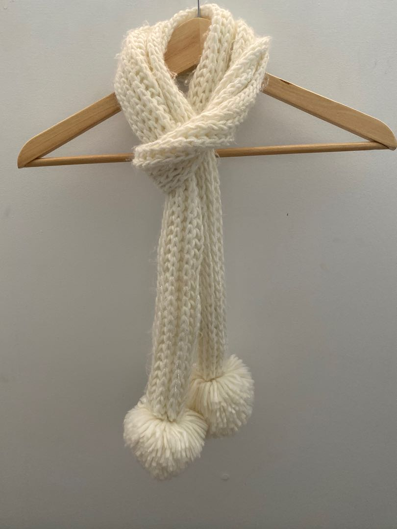 White knit scarf with pom-poms and silver detailing