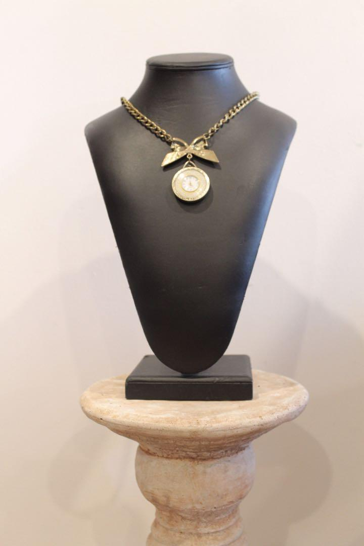 Beautiful golden chain with (non-working) pocket watch.