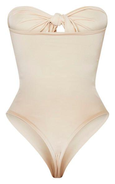 nude bow front cut out swimsuit.  pretty little thing