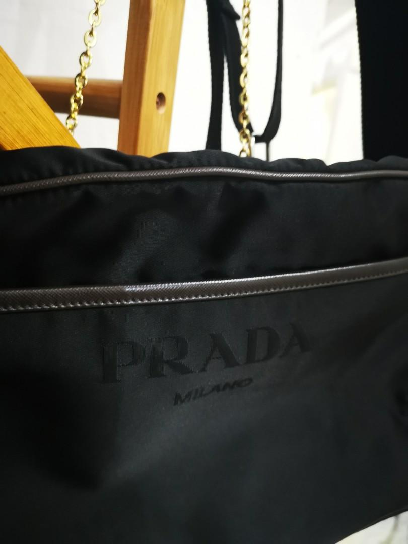 Authentic Prada Sling shoulder Bag come w Authentic Card Bag Leather n Inner no cracks no damage no broken no tears no scratches in Good condition (Adjustable strap length