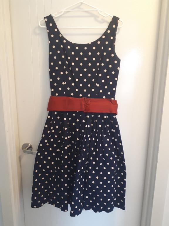 Navy polka dot 50s style dress with red belt. Size 16