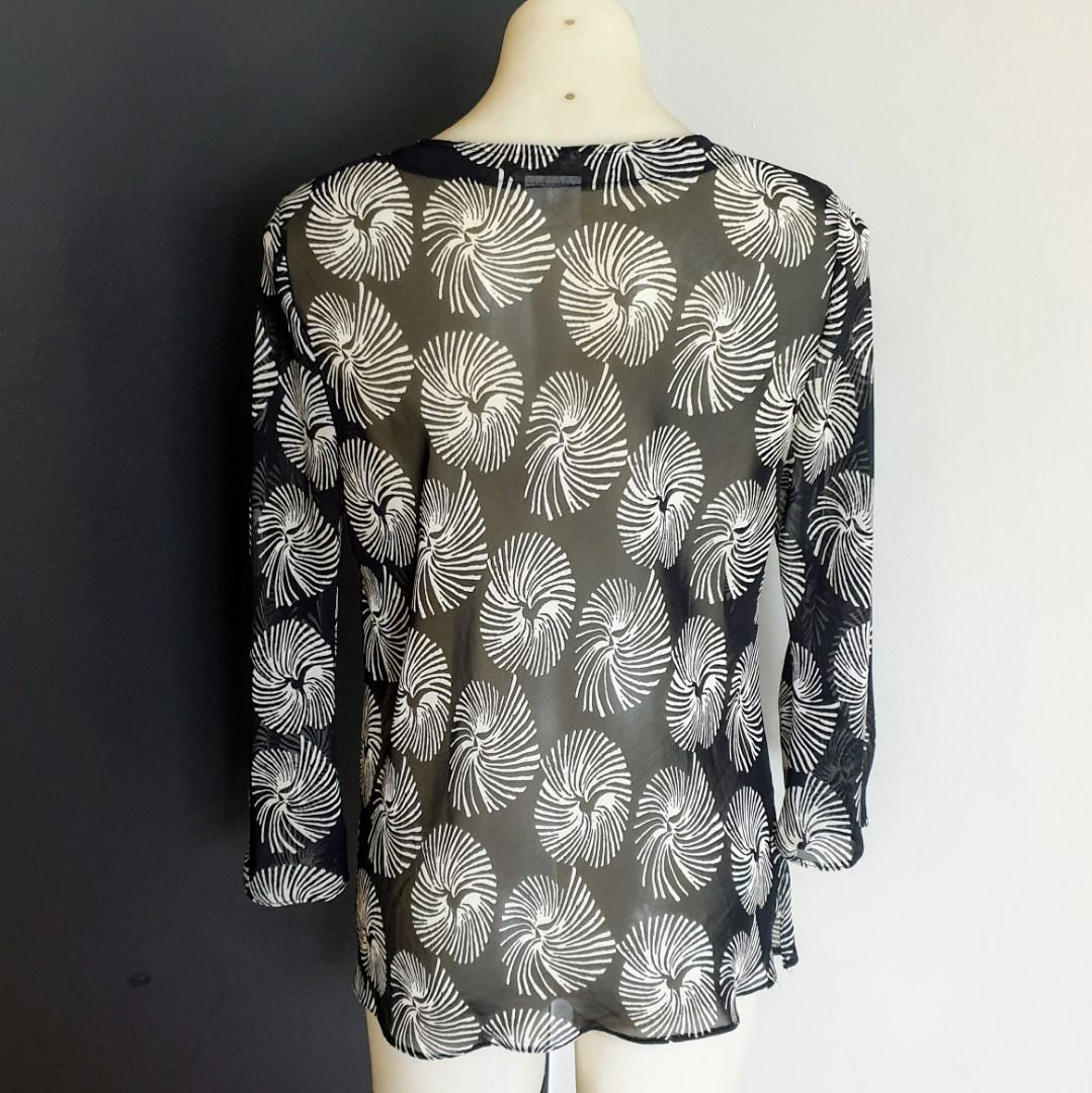 Women's size 10 'CHIOS' Gorgeous black and white swirl sheer long sleeve blouse
