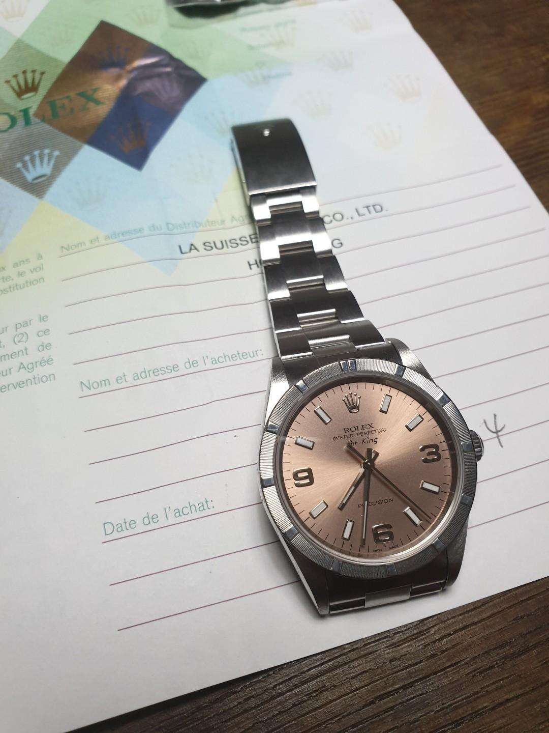 The Rolex Air King 14010M 34mm with salmon dial with engine turned bezel Y series with papers.