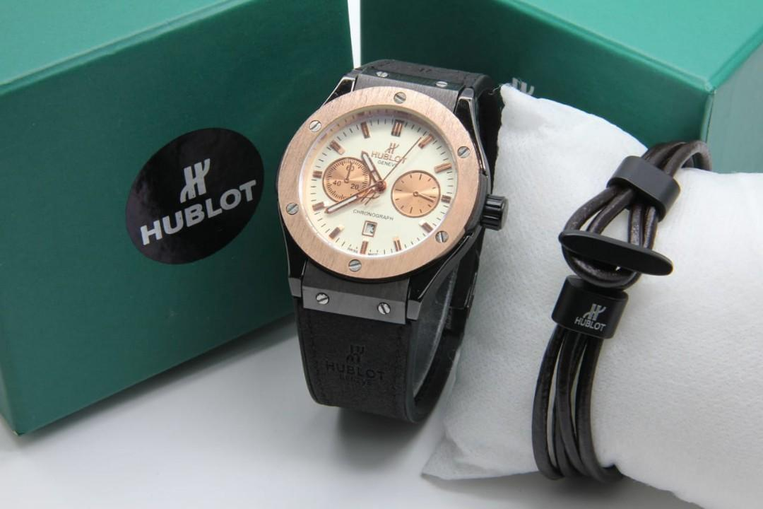 Brand : Hublott Paket  Kualitas : Super  Display : analog, chrono off, tgl on  Diameter : -+4,2cm Tali : rubber  Free Gelang  Free box exclusive  Free baterai analog Free bubble