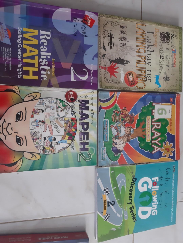 Grade 2 books: Following God, Mapeh, Math and Bagong lakbay ng lahing pilipino