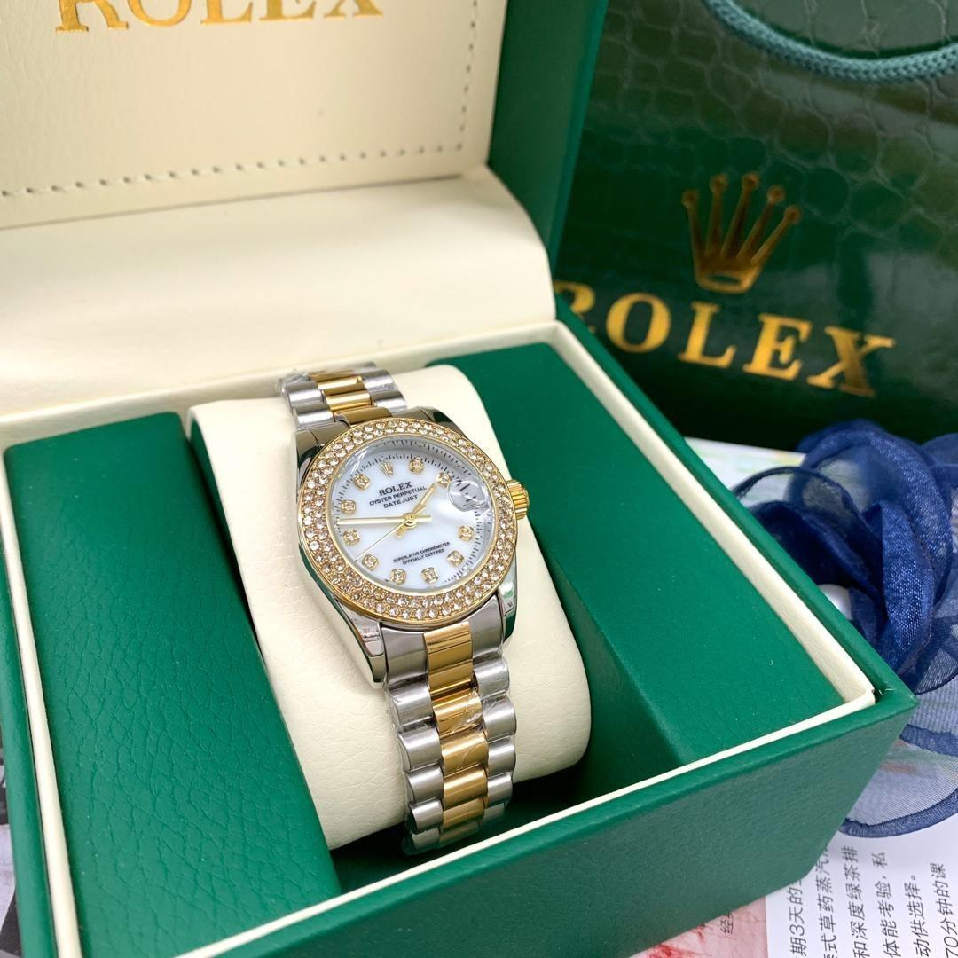 Rolex gold/rosegold   with box rolex   • Material Standard steel • Gender Girl  • 1 Month Warranty mesin • Battery  • • Date function