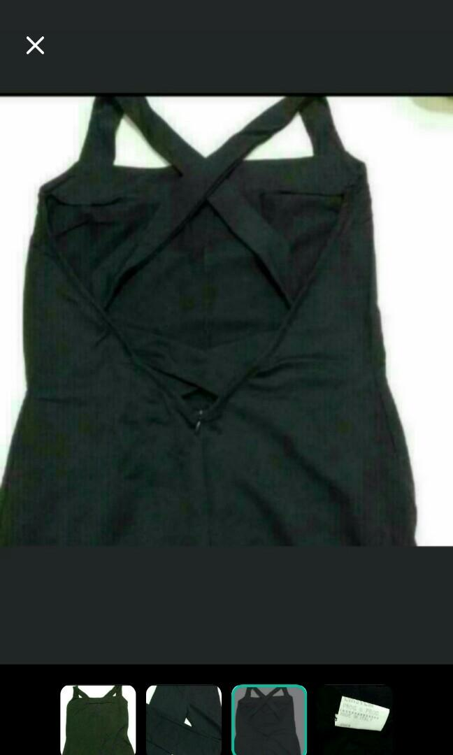 PRICE REDUCED. Made In Italy Black Jumpsuit With Strapped Detail. Small size. Has a stretch. Bought $199 plus as a sample. This is a quick sale price.