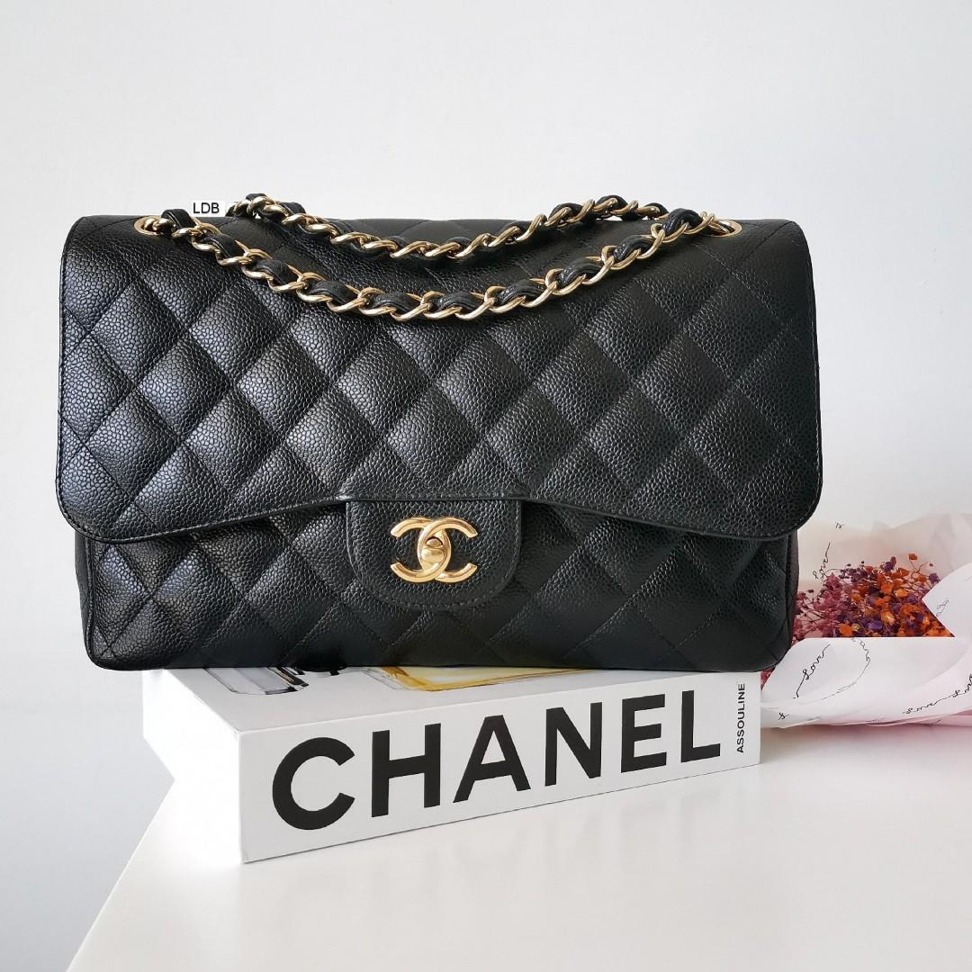 Authentic Chanel Classic Jumbo Black Caviar with Gold Hardware Double Flap