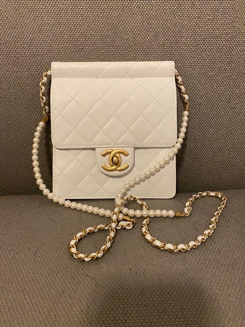 Brand new white hand bag with pearl shoulder strapped