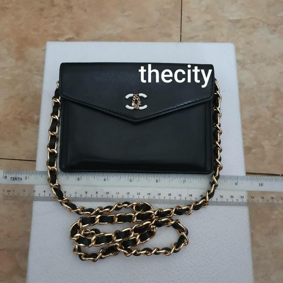 AUTHENTIC CHANEL BLACK CALFSKIN LEATHER- ORGANIZER POUCH / WALLET- CC LOGO DESIGN - LEATHER IN GOOD CONDITION, CLEAN INTERIOR- GOLD HARDWARE- COMES WITH EXTRA ADD STRAP
