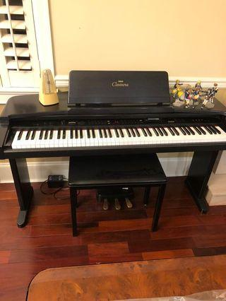 Yamaha Clavinova Electronic Piano with chair