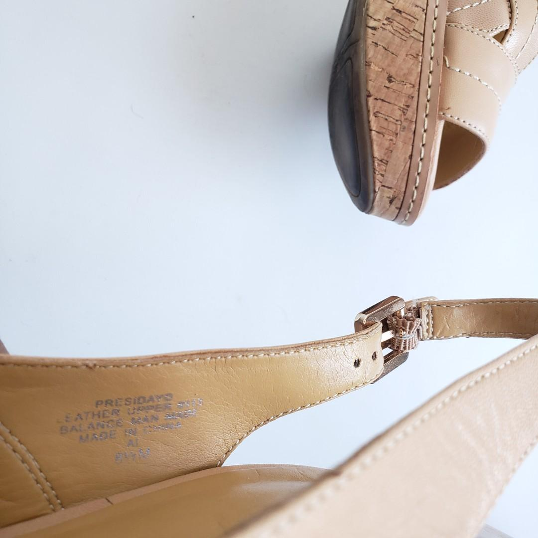 Nine West Presidayo Nude Platform Slingback Heels.