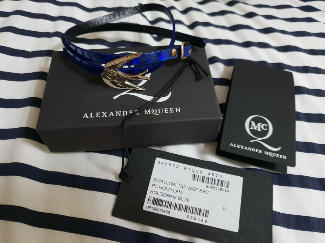 Authentic Alexander McQueen Holographic blue leather wrap bracelet. Silver tone swallow embellishment, designer engraved. Buckle fastening. Presented in a designer-stamped box. Colour: blue