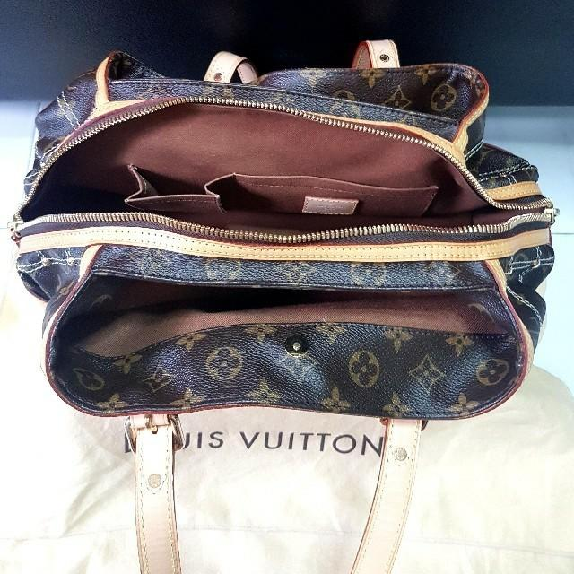 Authentic Louis Vuitton Bag  Limited Edition Riveting Brown & Gold Tote Bag *Limited Edition**Includes: Original Dustbag and receipt*  Used once only in very good condition, look as good as new.