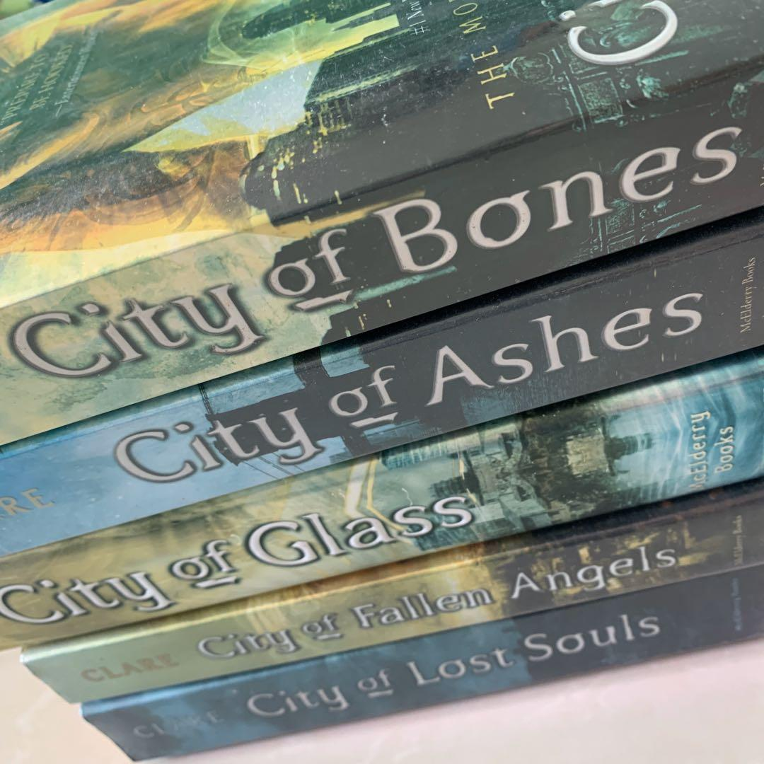 THE MORTAL INSTRUMENTS CITY OF BONES CITY OF ASHES CITY OF GLASS CITY OF FALLEN ANGELS CITY OF LOST SOULS BY CASSANDRA CLARE