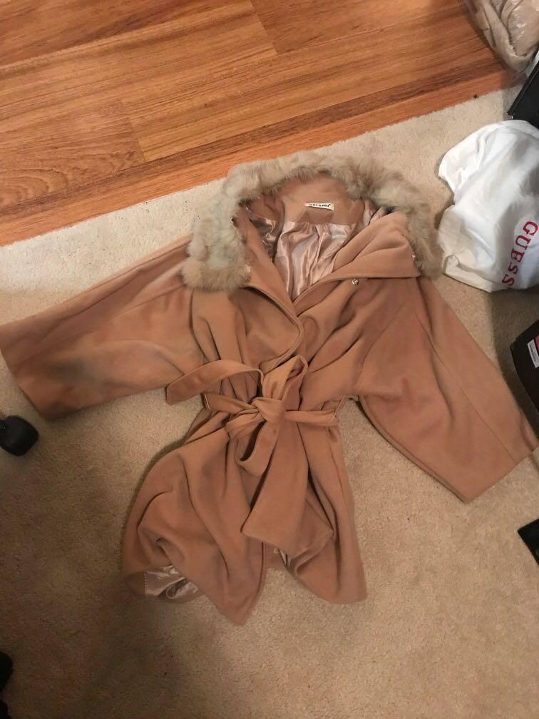 Tan coloured light jacket with removable fur and hood