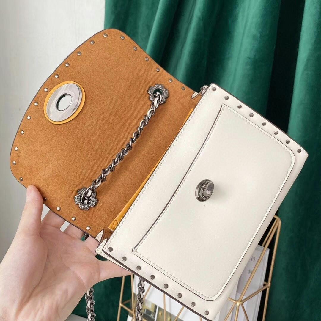 Coach trumpet chain bag full leather material package edge rivet hanging decoration flower adornment cute little joker can shoulder worn