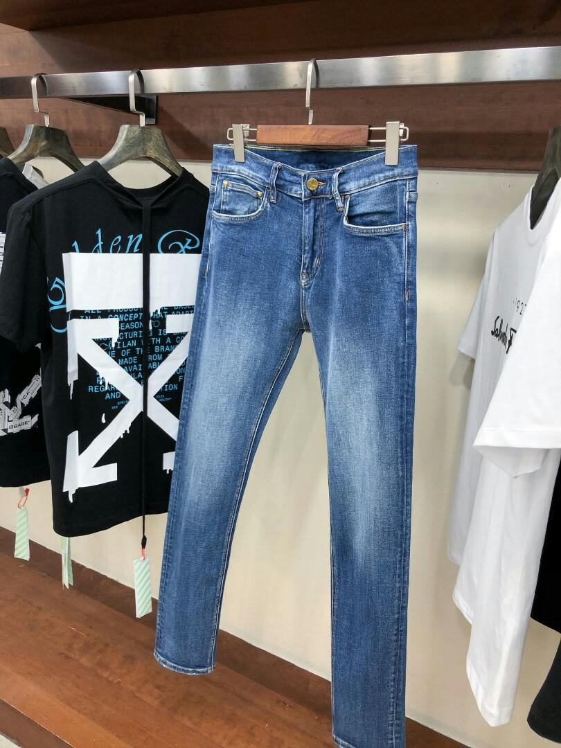 ueLouis ss chun xia fashionable jeans washed blue joker men after stretch denim trousers pocket metal color standard decoration and leisure travelers