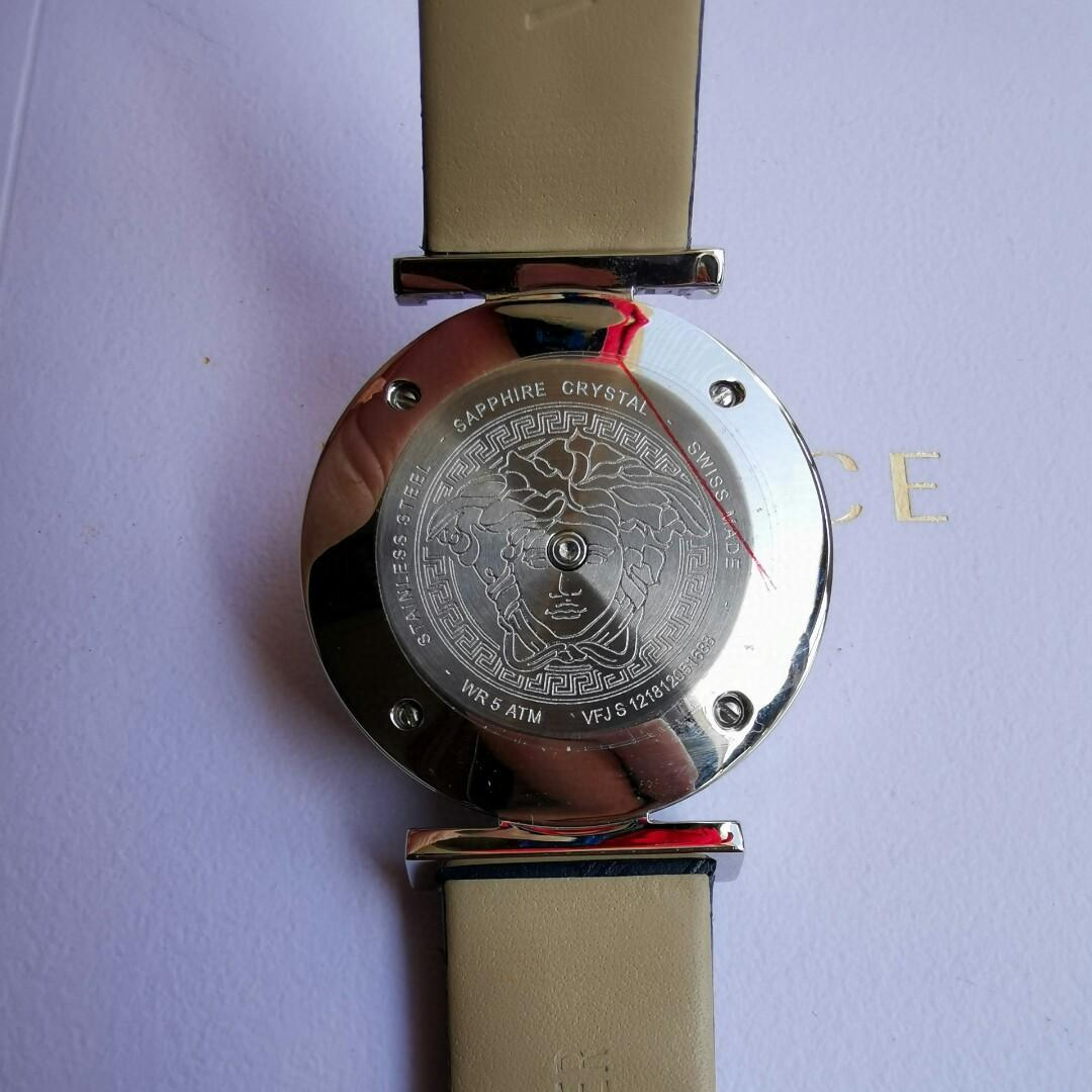 Original Original A wrist watch with a knob - central watchcase rotating between open and interesting little game