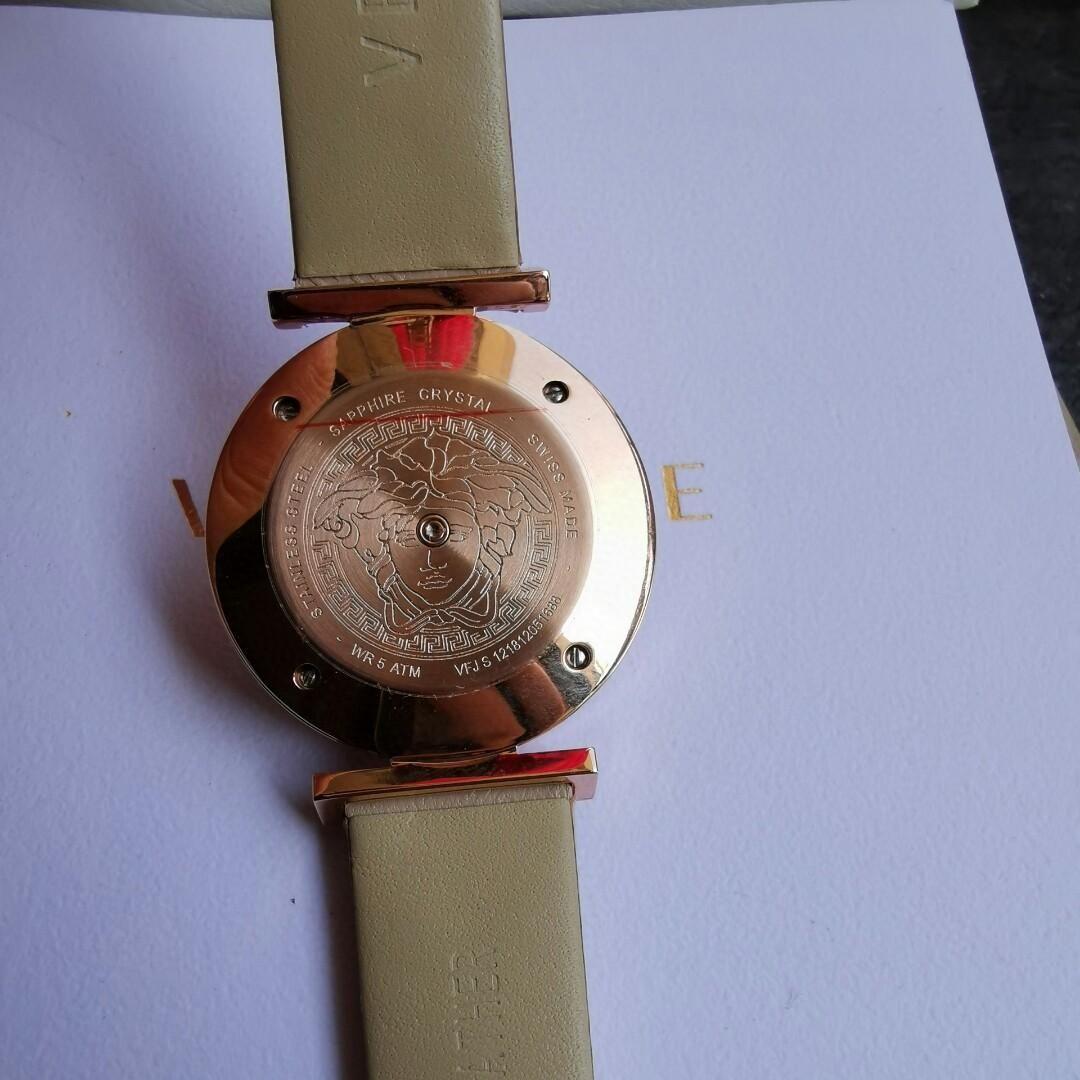 Original A wrist watch with a knob - central watchcase rotating between open and interesting little game