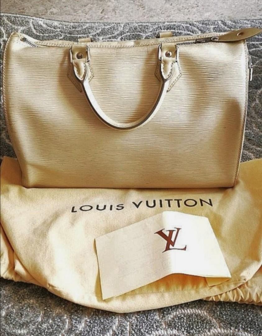 Authentic with code.  Pre-Loved Classic Louis Vuitton/LV Epi Handbag Speedy 30. Ivory White Leather. Women Female. Branded goods. Still in good condition and shape. Iconic Designs of LV