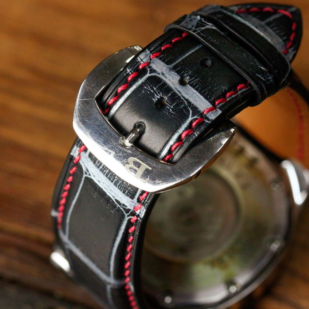 Handmade handstitched watch strap in metallic black brushed silver alligator leather for client's bally watch