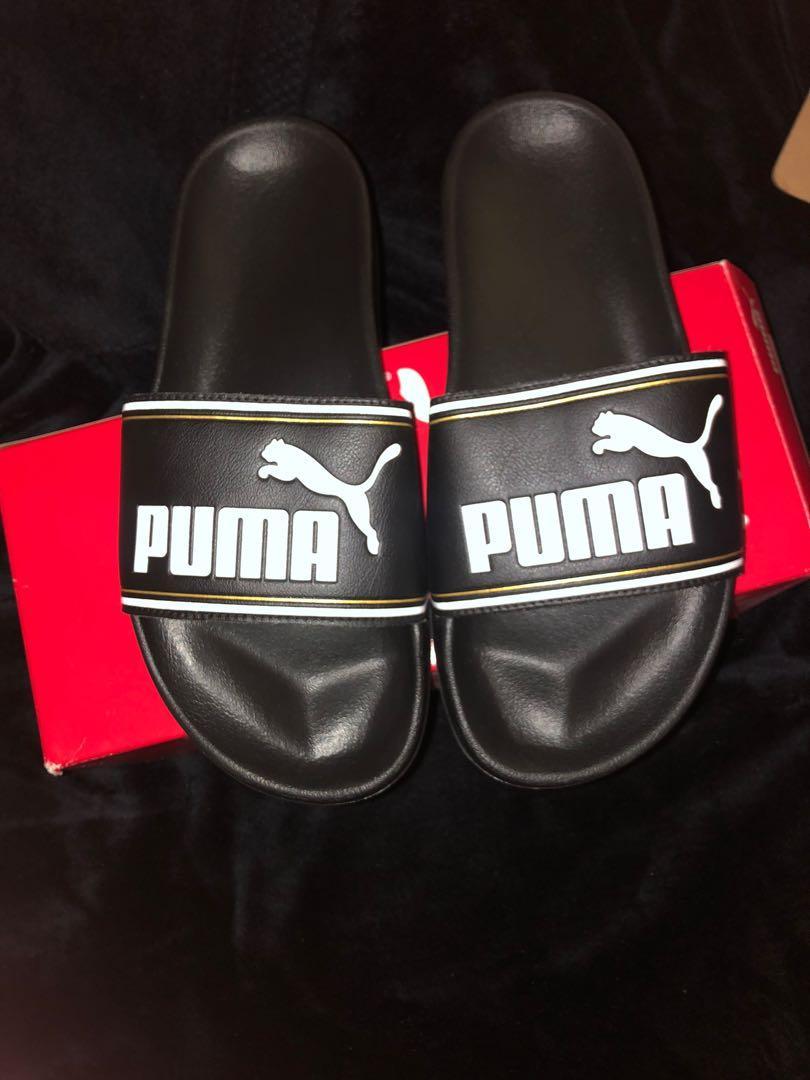 Black puma slides