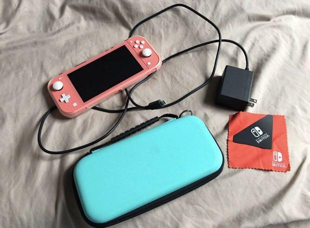 Nintendo Switch Lite + 16 games