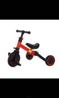 White Kids Learning Tricycle