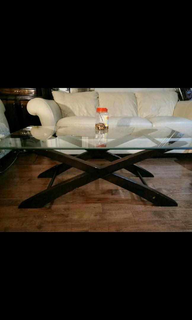 Glass top coffee table 52X28X19in.