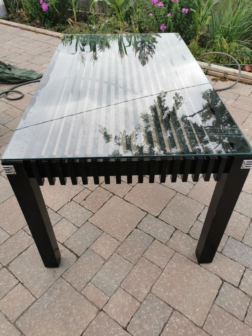 Glass top hard wood dining table 5X3 ft
