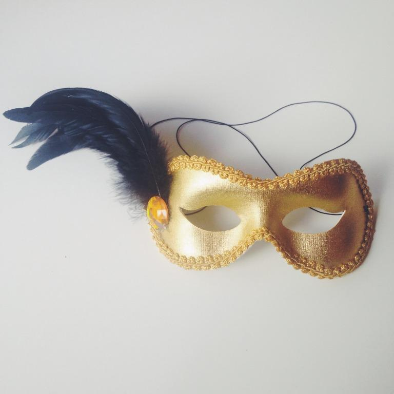 Gold Mask with Black Feather