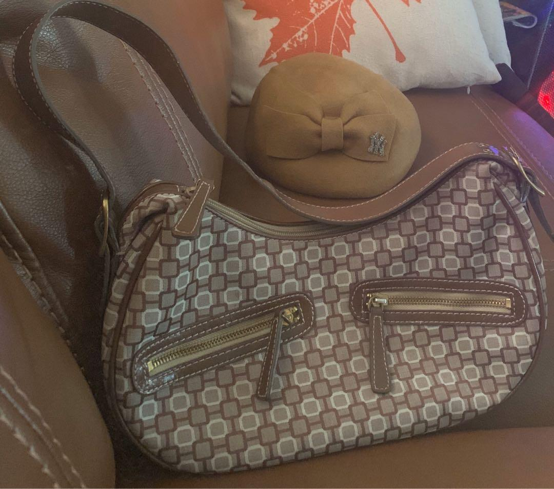 A brand new Nine West purse with a brand new dressing hat included