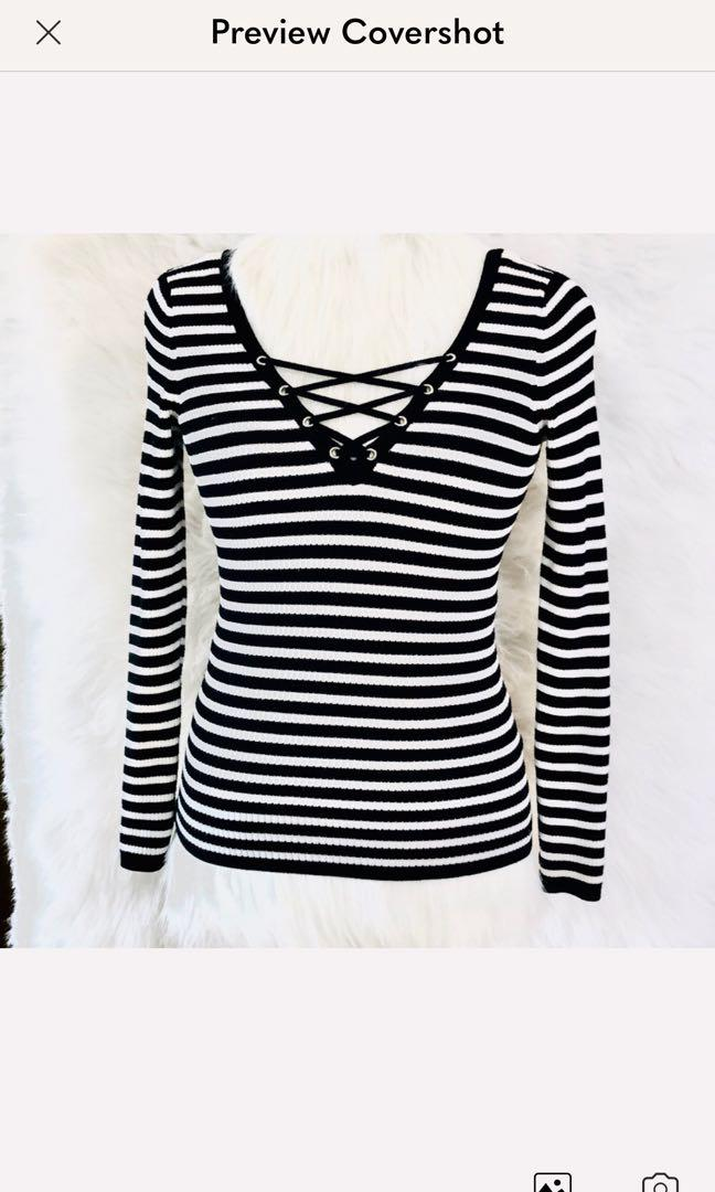 Black and white GUESS long sleeved shirt. Never worn.