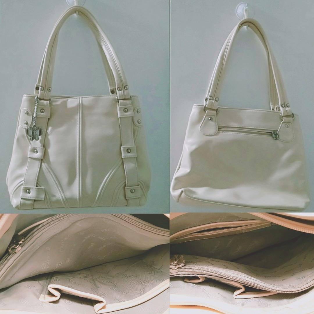 Ivory coloured handbag with a beautiful silver butterfly side chain