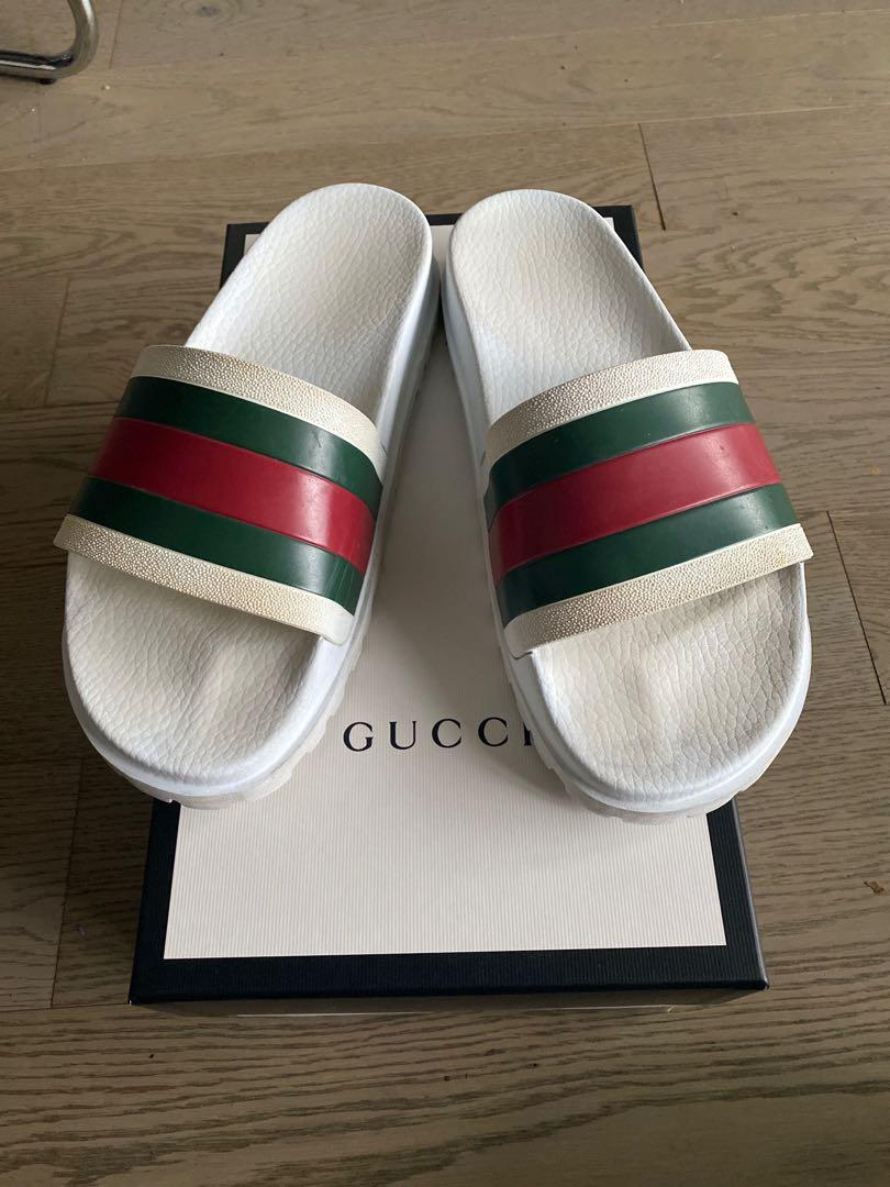 Gently used, authentic gucci slides.  Condition: slight discolouration from wear, no tears, no scuffs.  Comes with slides, gucci box and dust bags in perfect condition.
