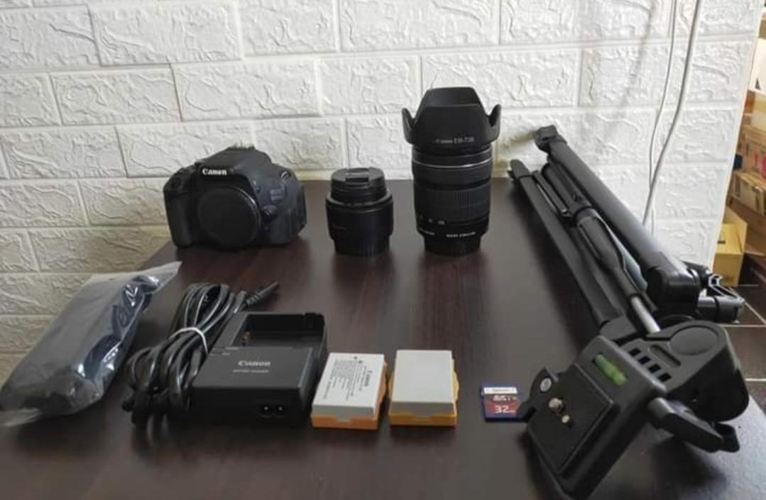 Eos BoDy+2 LEns+SD card+2 Battery+Charger+Tripod+Strap,18-55mm Lens + 18+135mm lens+Hood