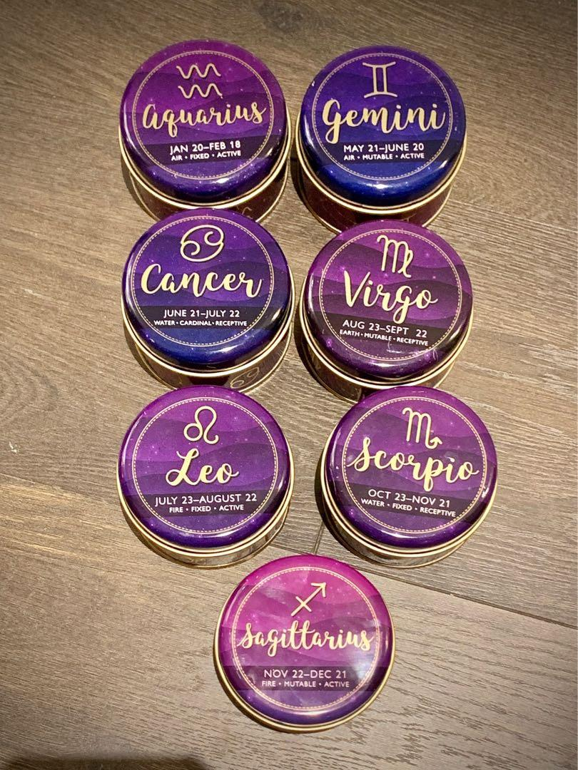 Astrology sign scented candles in a tin