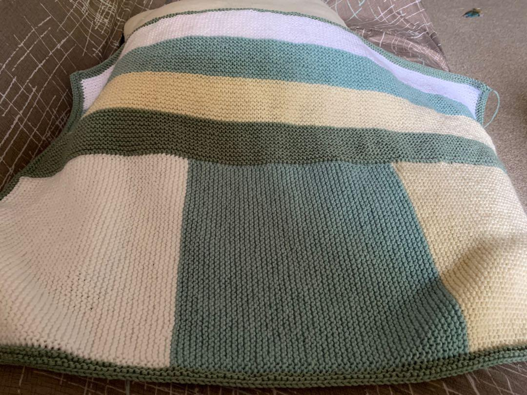 Hand knitted cot blanket