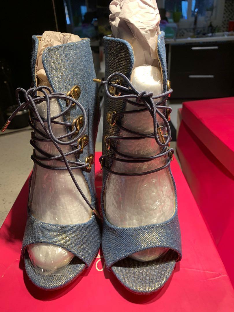 Brand new high heeled dress sandals. Size 8